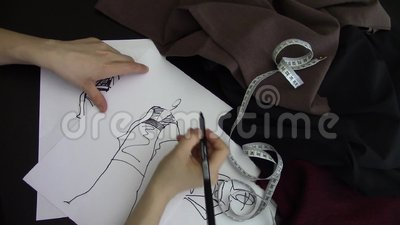 Fashion designer drawing. Hand footage stock video