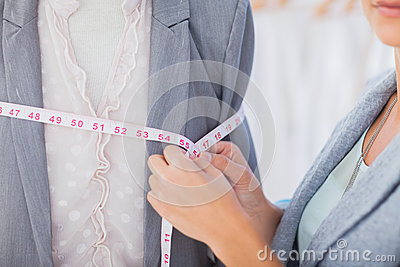Fashion designer measuring blazer