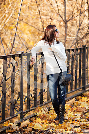 Fashion girl in autumn park