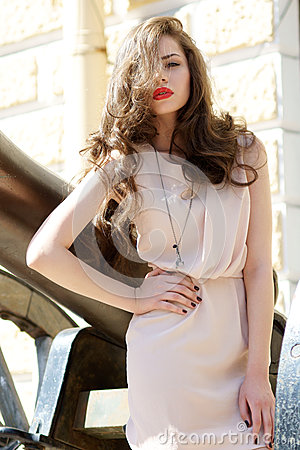 Fashion girl with long hair and red lips