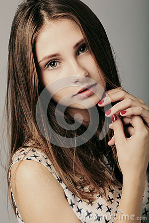 Fashion girl posing on grey background