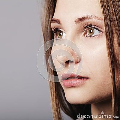 Fashion girl posing on grey background