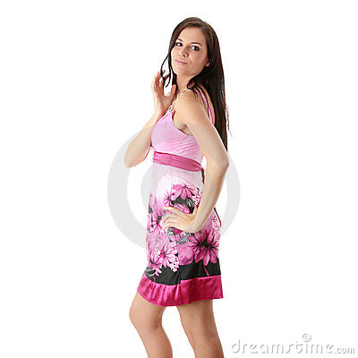 Fashion girl posing in pink dress