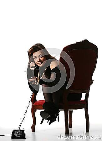 Fashion girl talking on old phone