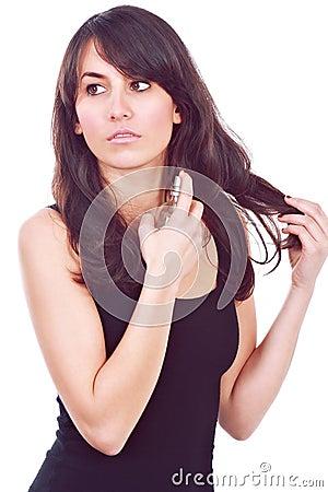 Fashion girl using a fragrance