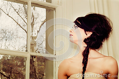 Fashion girl by window