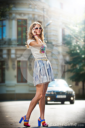 Free Fashion Girl With Short Skirt , Bag And High Heels Walking On Street Stock Image - 30184131
