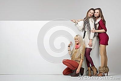Fashion girls with an empty board