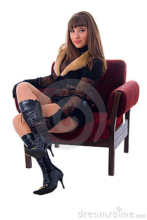Fashion Glamour Girl Sitting In Soft Chair.