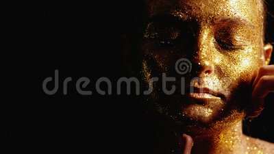 Fashion glitter makeup woman golden shiny face. Fashion glitter makeup. Beauty wellness. Tender woman touching golden shiny face stock footage