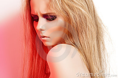 Fashion gloomy girl with make-up in rock red light
