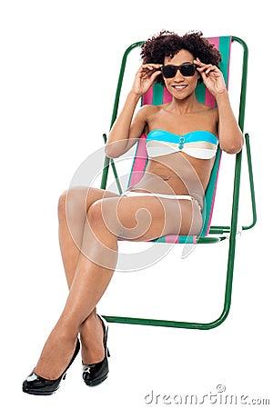 Fashion lingerie model relaxing on deckchair