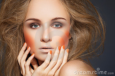 Fashion make-up, blusher, manicure, big hairstyle