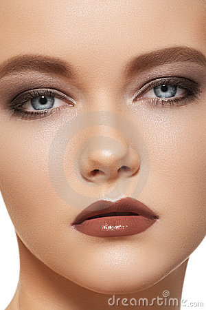 Fashion make-up with brown eyeshadows and lipstick