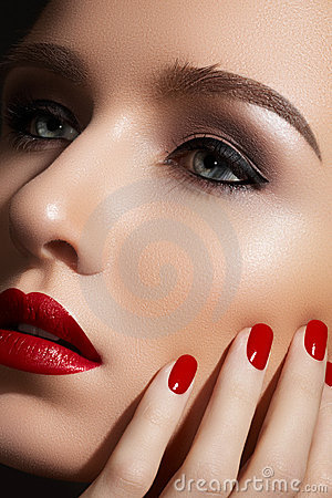 Fashion make-up and manicure. Sexy red lips, nails