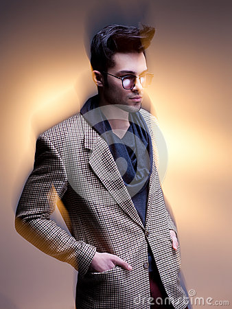 Fashion man model dressed casual posing dramatic