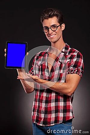 Fashion man presenting a new tablet pad