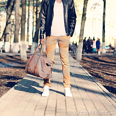 Free Fashion Man Stands With A Bag In His Hand Outdoors Closeup Royalty Free Stock Photos - 103844088