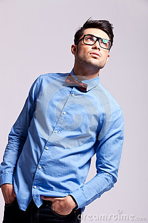 Fashion man wearing bow tie and glasses looks up