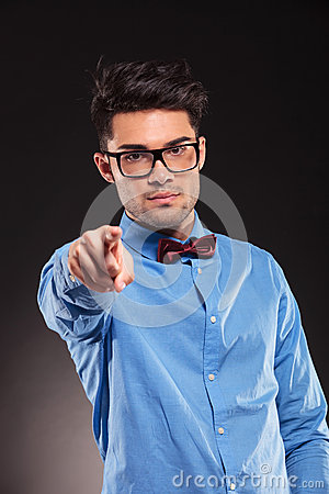 Fashion man wearing bow tie pointing