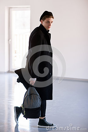 Free Fashion Man With Backpack In Studio Stock Photography - 93017002