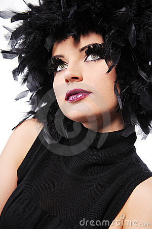 Fashion model with black feathers as hair.