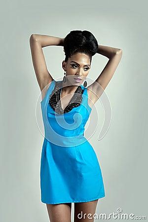 Fashion model in blue dress