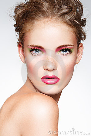 Fashion model with bright make-up, curly hairstyle