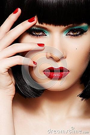 Fashion model. Christmas glitter make-up, manicure