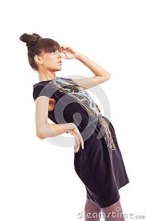Fashion model in a dark colour dress