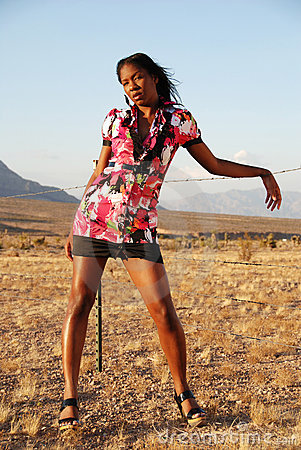 Fashion model in desert.