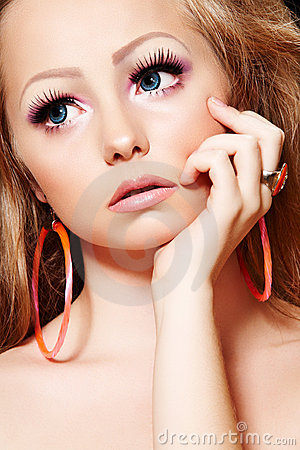 fashion model with doll makeup long eyelashes stock
