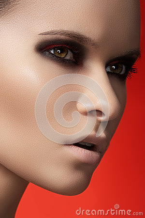 Fashion model face with dark make-up & purity skin