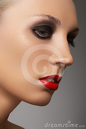 Fashion model face with red lipstick & smoky eyes