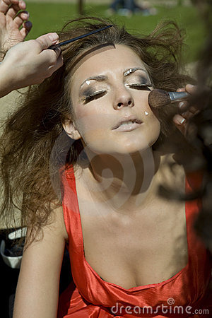 Fashion model girl doing makeup.