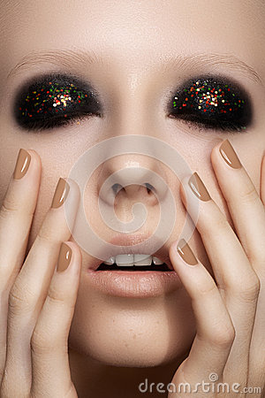 Fashion model with glitter make-up, shiny manicure