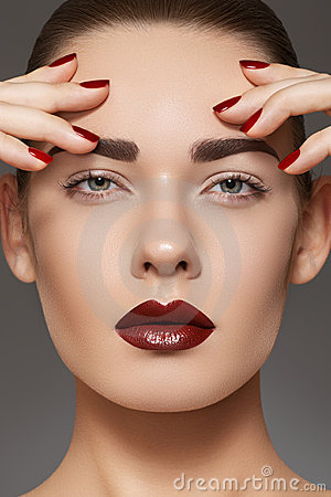 Fashion model with lips make-up, manicure on nails