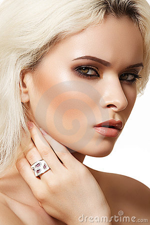 Fashion model with luxury make-up and chic jewelry