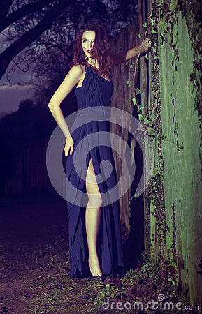 Fashion Model in Modern Blue Dress posing Outdoors