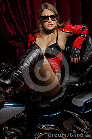 Fashion model with motorbike