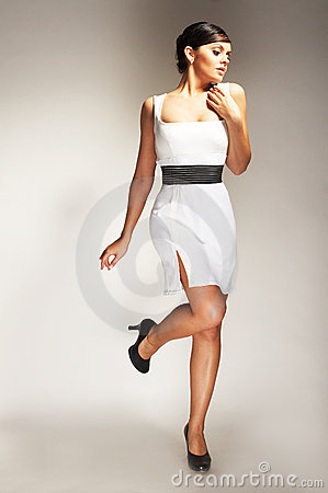 Fashion model posed in white dress