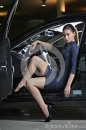 Fashion model posing in a car