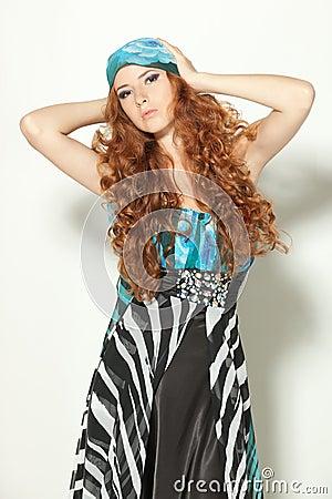 Fashion model posing in chiffon dress
