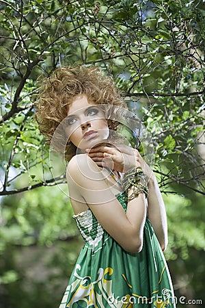Fashion model posing outdoors