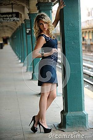 Fashion model posing pretty in NYC subway