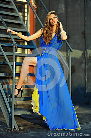 Free Fashion Model Posing Sexy, Wearing Long Blue Evening Dress On Rooftop Location Stock Photography - 31815122