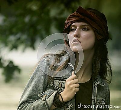 Fashion model posing in summer park