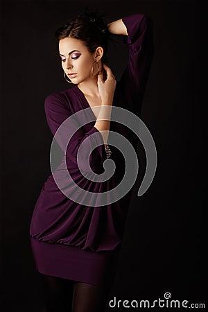 Fashion model in purple mini dress