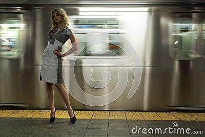 Fashion model standing at NYC subway