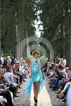 Fashion model wearing a turquoise dress Editorial Stock Image